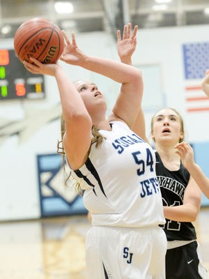 Enka senior Macee Kirkpatrick (54) has committed to play college basketball for Maryville (Tenn.).