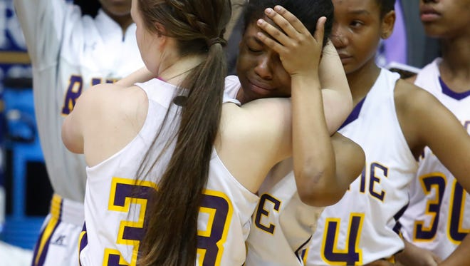 Rayne players Abby Royer (left) and Tiesha Young comfort each other  in the Class 4A State Championship game on Saturday night 3/5/16 in the University Center gym on the campus of Southeastern Louisiana University.   