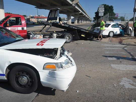 A Skylark Taxi cab and a Ford Taurus collided at the