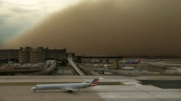 A dust storm is seen at Phoenix Sky Harbor International Airport on Friday, July 25, 2014.
