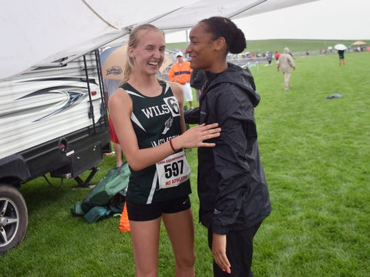 Galileo Magnet High School's Talasjah Weathersby congratulates Wilson Memorial's Paige Miller after she won the Class 2 girls 300-meter hurdles at the VHSL Class 1 & 2 track championships on Saturday June 2, 2018, at East Rockingham High School in Elkton, Va. Weathersby will be rooming with Paige's sister Emilie when they start at Radford University in the fall.