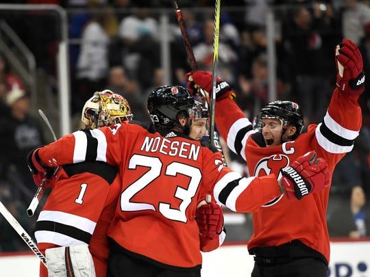 The Devils celebrate a 2-1 win over the Toronto Maple Leafs at the Prudential Center in Newark, NJ on Thursday, April 5, 2018.