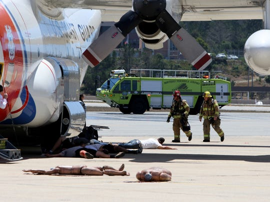 Firefighters respond to a plane crash simulation with multiple victims at the Monterey Regional Airport on Tuesday.