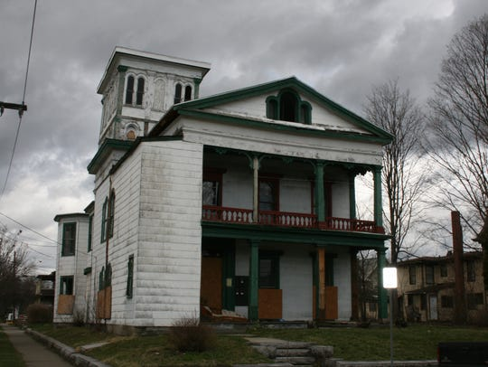A vacant, foreclosed property on West First Street