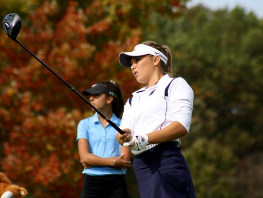 DeWitt's Elaina DeRose tees off at the 16th hole at