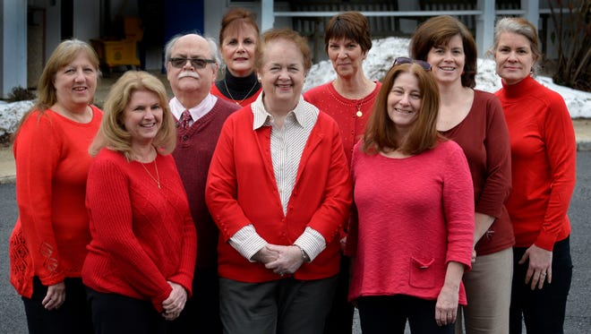 """Fanwood Borough Administrator Eleanor McGovern, center in front, and the Borough Hall staff pose in support of the American Heart Association's """"Go Red"""" event in Fanwood, NJ, Thursday, Feb. 4, 2016. The staff includes, from left, Joy Veeck, Colleen Huehn, Fred Tomkins, Doreen Caccholi, McGovern, Lisa Halloran, Pat Hoynes, Patricia Celardo and Donna Zucker."""