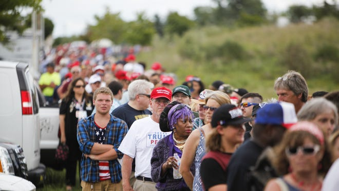 Hundreds wait in line outside of Summit Sports & Ice Complex Aug. 19, 2016, before GOP presidential candidate Donald Trump's rally in Dimondale.