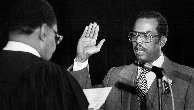 October 1, 1982 - J.O. Patterson is sworn in as interim Mayor of Memphis on October 1, 1982, becoming the first black to occupy the city's highest office. He was sworn in after Mayor Wyeth Chandler (not shown) stepped down to become a Circuit Court Judge. Mayor Patterson is being sworn in by Criminal Court Judge H.T. Lockard (left). He was flanked by his father, Bishop J. O. Patterson (not shown), head of the Church of God in Christ and Bishop Carroll T. Dozier (not shown) of the Catholic Diocese of Memphis.