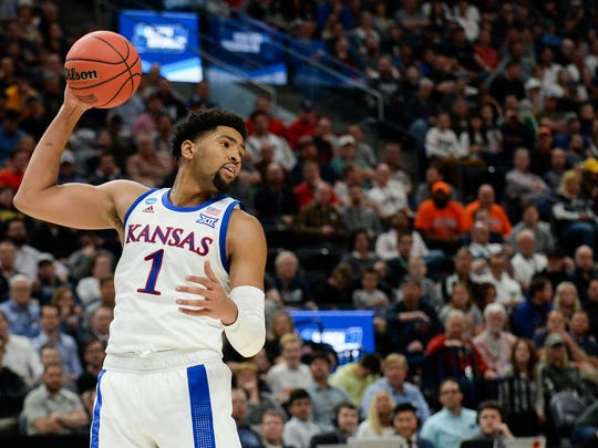 Kansas forward Dedric Lawson (1) grabs a rebound against Northeastern in the first round of the NCAA Tournament on March 21, 2019, in Salt Lake City.