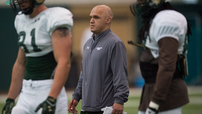 Ricky Santo, an offensive quality control assistant, works with CSU players during an Aug. 25 practice. Santo is battling cancer again after seemingly beating the disease a little more than a year ago.
