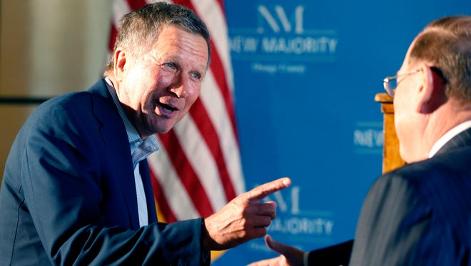 """John Kasich, shown meeting major donor George Argyros last week, will appear on """"Late Night with Seth Meyers"""" tonight."""