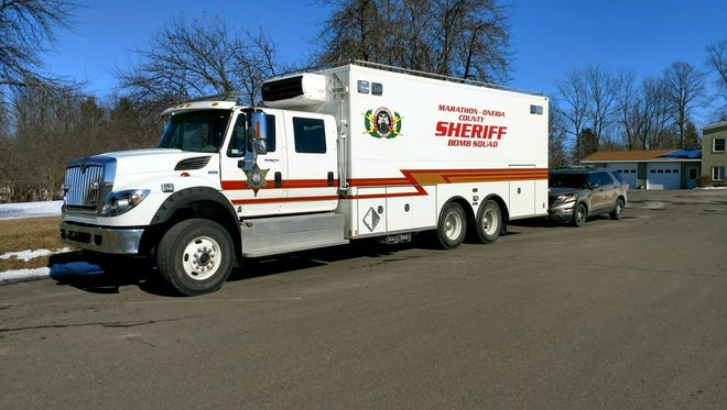 The Marathon County Bomb Squad responds to Neillsville Friday when a hand grenade was found during a search of a home.