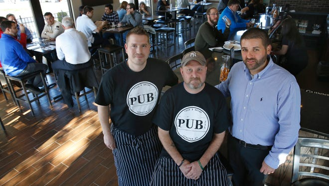Executive chefs Nathaniel Wilkins and Kurt DeJac next to owner Bill Horeth at Pub 235 in Webster.