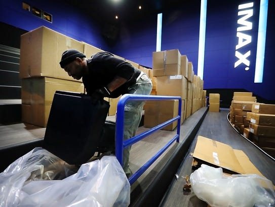 Derrick White unboxes the cushy seats for the new Imax