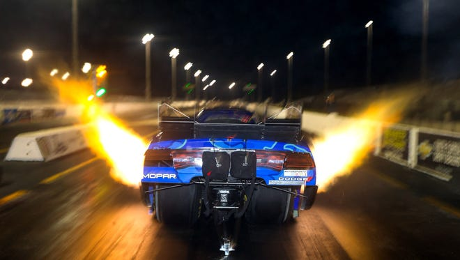 Jan. 14, 2015; Jupiter, Fla.; NHRA Funny Car driver Jack Beckman makes a run during preseason testing at Palm Beach International Raceway.