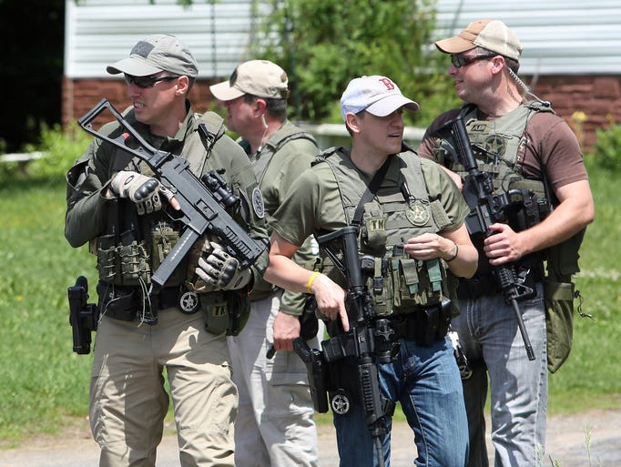 Law enforcement officers from several different agencies