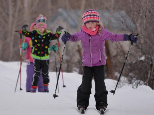 Children younger than 17 years old ski free on the Methow Trails in north central Washington near Winthrop.