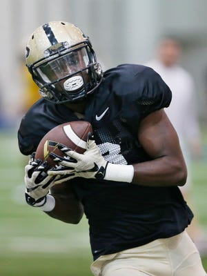 Wide receiver Bilal Marshall with a pass reception during spring football practice Thursday, March 24, 2016, inside the Mollenkopf Athletic Center on the campus of Purdue University.