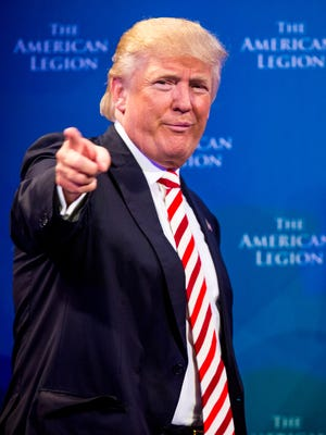 Donald Trump, Republican Presidential candidate, points to the crowd waiting to meet him, after he addressed the American Legion on September 1 at the Duke Energy Convention Center in downtown Cincinnati.