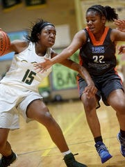 Captain Shreve's Dezyre Black, left, heads to the hoop