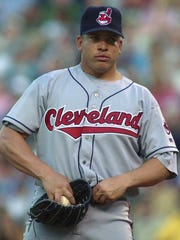 A young Bartolo Colon pulls on his waistband during