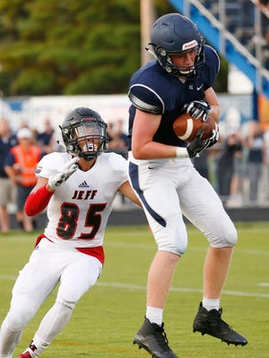 Andrew Page of Central Catholic intercepts a pass intended for Jay Segal of Lafayette Jeff Friday, August 18, 2017, at Central Catholic. Jeff pounded CC 54-0.