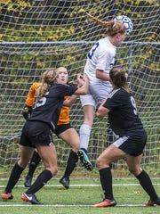 Morris Catholic senior defender Emily Schum (3) tries