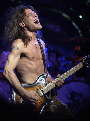 FILE - In this Aug. 5, 2004 file photo, Van Halen guitarist Eddie Van Halen performs in Phoenix. Van Halen, who had battled mouth cancer, died Tuesday, Oct. 6, 2020. He was 65.