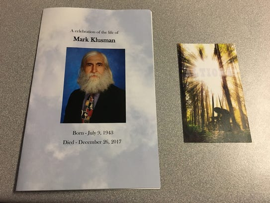 A program and card from the funeral of Elder High School