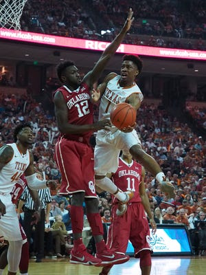 Texas Longhorns guard Isaiah Taylor (1) shoots the ball as Oklahoma Sooners forward Khadeem Lattin (12) defends during the first half at the Frank Erwin Special Events Center.
