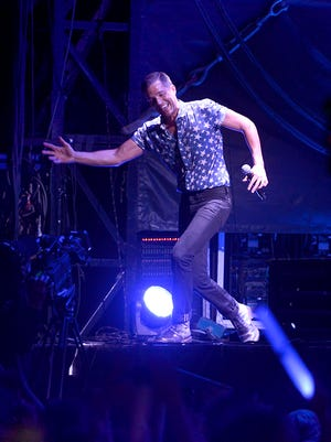 """Brandon Flowers of The Killers sings """"Spaceman,"""" as the opening song on Saturday night at Hangout Music Fest."""