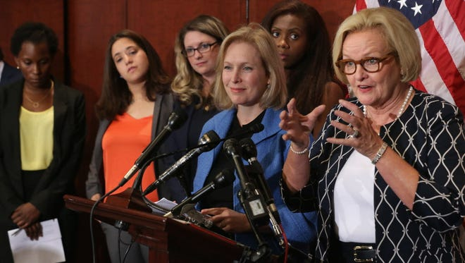 With survivors of campus sexual assaults, Democratic Sens. Claire McCaskill of Missouri, right, and Kirsten Gillibrand of New York discuss legislation in July.