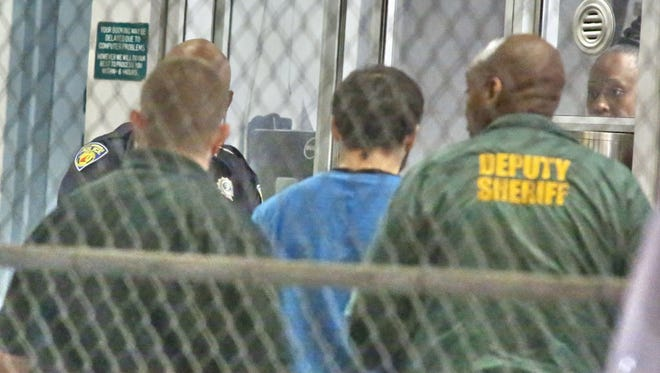 Esteban Santiago is taken into custody in Fort Lauderdale on Jan. 6, 2017.