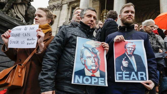 People protest against President Trump's executive immigration ban, in Brussels on Jan. 30.