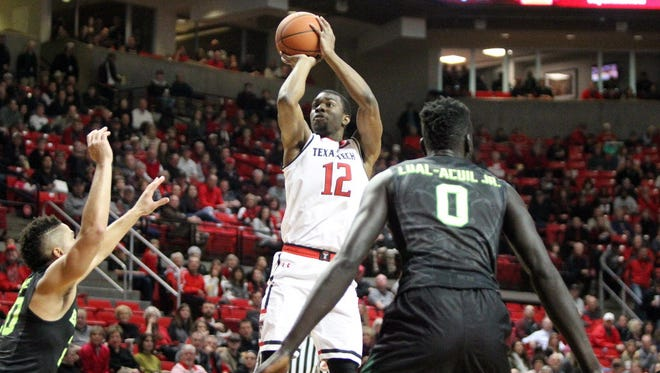 Texas Tech guard Keenan Evans (12) attempts a shot against Baylor in the first half.
