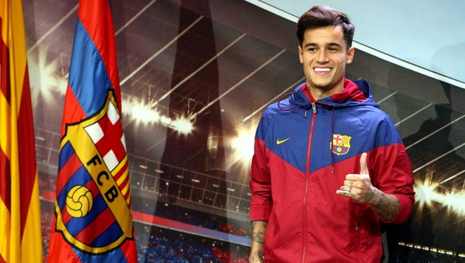 Philippe Coutinho reacts upon his arrival at FC Barcelona.