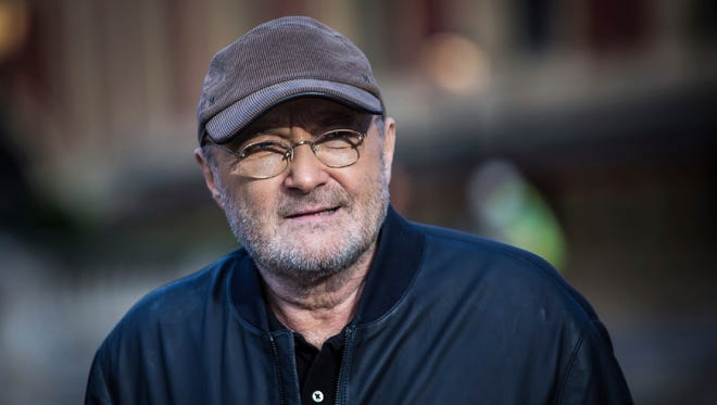 Singer Phil Collins poses for photographers during a photo call to promote his upcoming tour and book 'Not Dead Yet' in London in October 2016. The tour comes to Cleveland this summer.