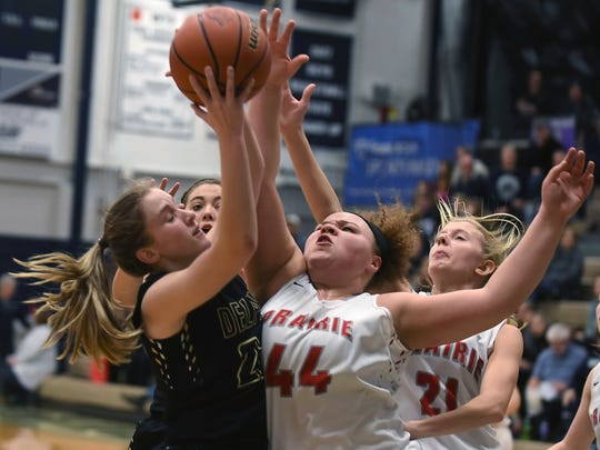 Delphi's Jordyn Gasser and Clinton Prarie's Kylie Burris battle for control of a rebound as the Oracles and Gophers face off in sectional play Friday night at Central Catholic.