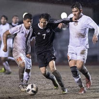 Boys soccer: Hawks topple Tribe 3-1 in downpour