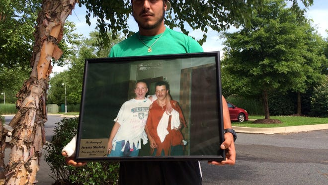 Thorne Guessford displays a photo of himself and his best friend and cousin, Jeremy Shalaby, who died 10 years ago in an ATV crash.