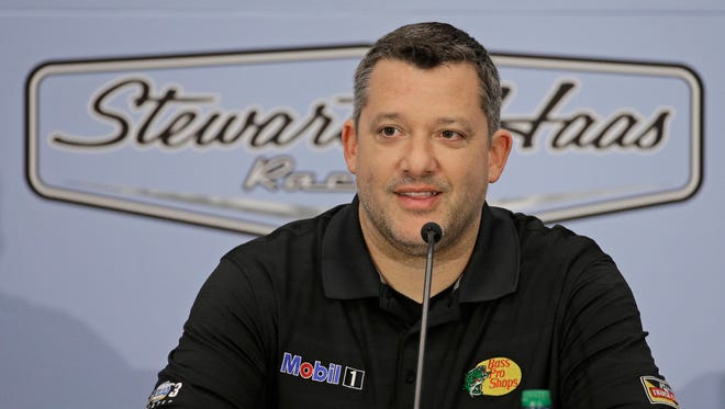 Three-time NASCAR champion Tony Stewart announces he will retire after the 2016 season during a news conference Wednesday.