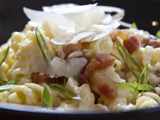 The River Market offers a variety of meals. White truffle mac and cheese with house cured bacon, smoked gouda, scallions, and pecorino cheese.