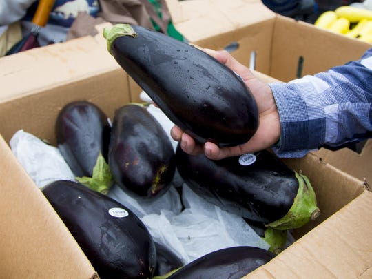 A box of eggplant are part of the rescued produce for