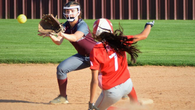 Sweetwater's Annaliese Espinoza slides into second base as Brownwood's Victoria Sanchez fields the throw in the fifth inning of Friday's game in Brownwood.