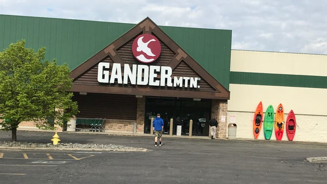 The Gander Mountain outlet in Johnson City will remain open under the ownership of Marcus Lemonis, CEO of Camping World and CNBC personality.