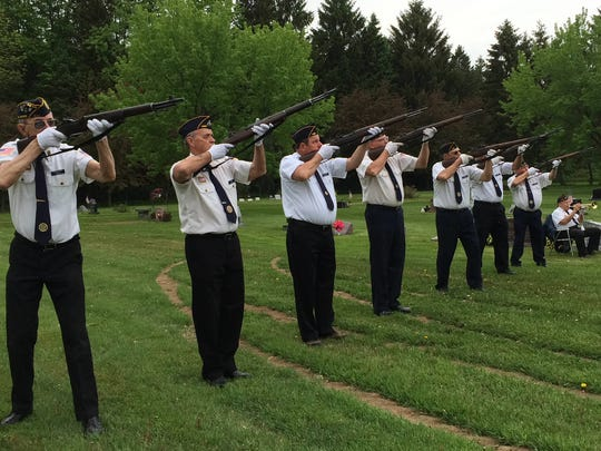 Members of the Elmer Blonien Post 485 American Legion rifle squad send off a 21-gun salute Memorial Day, 2015.