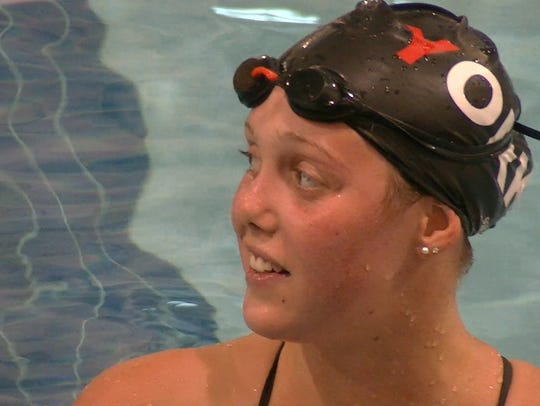 Leah Braswell of Manchester listens to instructions