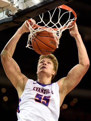 MIKE LAWRENCE / COURIER & PRESS      University of Evansville's Egidijus Mockevicius gets a monster dunk in the first half of Saturday's game with Bradley at the Ford Center, January 9, 2016.