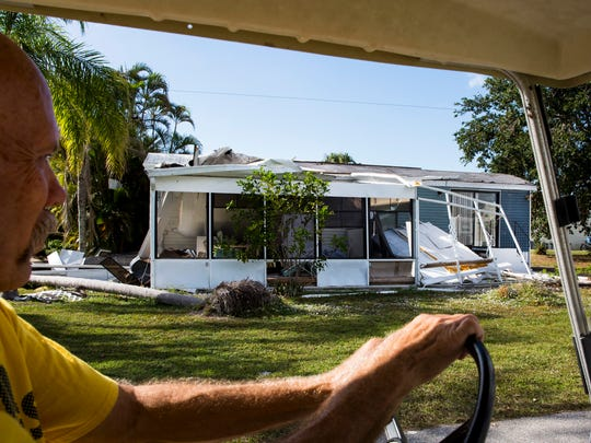 Dave Stroshein drives past a damaged trailer at Citrus Park in Bonita Springs, Fla. on Wednesday, Dec. 6, 2017. Three months after Hurricane Irma passed through Southwest Florida, many mobile homes, mostly owned by season residents, remain untouched.