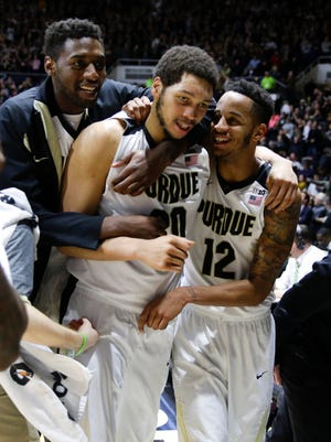 Purdue center A.J. Hammons (20), center, celibates with forward Vince Edwards (12) and forward Jacquil Taylor (23) following an NCAA college basketball game in West Lafayette, Ind., Tuesday, Feb. 9, 2016. Purdue defeated Michigan State 82-81 in overtime. (AP Photo/Michael Conroy)